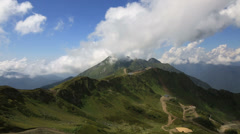 Clouds float above the caucasus mountains. krasnaya polyana. timelapse view Stock Footage