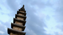 Time Lapse of clouds behind tower in temple Stock Footage