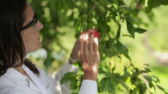 Portrait of young happy scientist by the apple tree HD Stock Footage