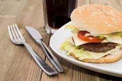 double cheeseburger with softdrink - stock photo