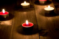 Group of candels burning in the night Stock Photos