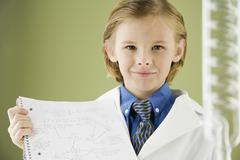Boy holding science notebook - stock photo
