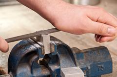grinding a block of metal - stock photo