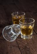three glasses of rum on wood - stock photo