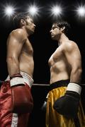 Boxers facing off in boxing ring Stock Photos