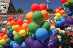 Multi-colored balloons at Stockholm gay pride - stock photo