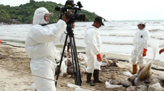 OIL SPILL DISASTER WORKERS SPRAY CHEMICAL DISPERSANTS CLEAN UP Stock Footage