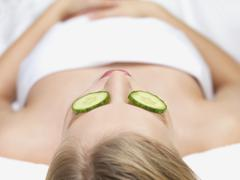 Young woman lying down in massage table Stock Photos
