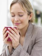 Stock Photo of Businesswoman enjoying coffee