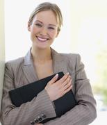 Portrait of businesswoman holding file Stock Photos