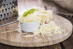 Emmentaler with cheese grater Stock Photos