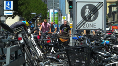 Germany Munich Downtown traffic bicycle biker pedestrian crossing zebra road Stock Footage