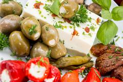 different types of antipasto on a plate - stock photo