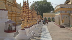 Tourists sightseeing The Shwezigon Pagoda Stock Footage