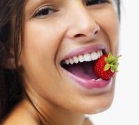 Stock Photo of Woman eating strawberry