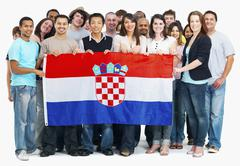 Group of people holding flag - stock photo