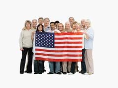Group of people holding an American flag - stock photo