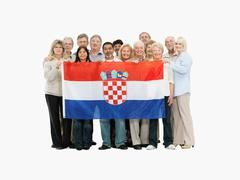 Group of people holding a Croatian flag - stock photo