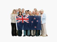 Group of people holding the New Zealand flag - stock photo