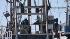 Oil and gas, drill rig platform detail, close up, good action Stock Footage