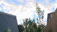 Stock Video Footage of Between Two Houses Sunset Time Lapse