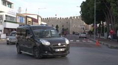 Kusadasi traffic and castle wall Stock Footage