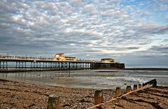Worthing pier and shingle beach Stock Photos