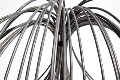 Abstract unravelled metal wire coil Stock Photos