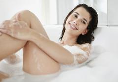 Woman in bubble bath - stock photo