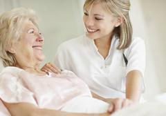 Nurse caring for a senior woman Stock Photos
