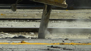 Stock Video Footage of Construction worker using pneumatic drills to destruct the surface of tram rail