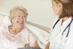 Nurse and senior patient Stock Photos