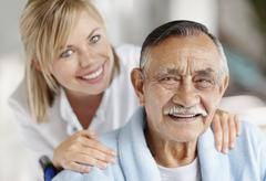 Nurse caring for senior patient Stock Photos