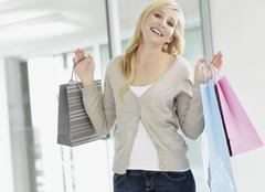 Stock Photo of Attractive woman holding shopping bags