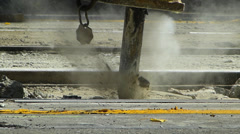 Construction worker using pneumatic drills to destruct the surface of tram rail Stock Footage