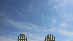 Lawn chairs with moving clouds - stock footage