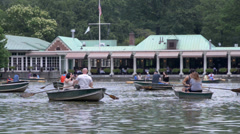 People, Tourists, Family in Row Boats in Central Park on Water Stock Footage