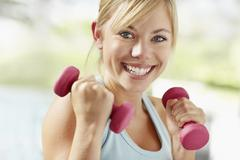 Stock Photo of Portrait of young blonde woman exercising