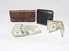 Women's and men's purse and dollars Stock Photos