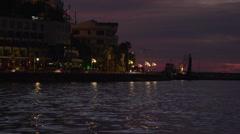 Kusadasi traffic along seawall night Stock Footage