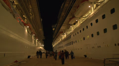 Cruise ships, tourists returning at night Stock Footage