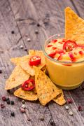 Fresh cheese sauce with nachos Stock Photos