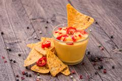 Fresh cheese sauce with nachos Stock Photos