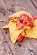some nachos with salsa sauce - stock photo