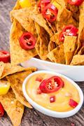 Fresh nachos with cheese sauce Stock Photos