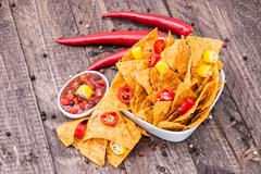 bowl of nachos with salsa sauce - stock photo