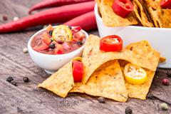 portion of nachos with salsa sauce - stock photo