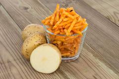 Stock Photo of potato sticks with fresh potatoes
