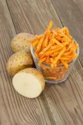 potato sticks with fresh potatoes - stock photo