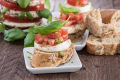 Fresh baguette with tomato and mozzarella Stock Photos